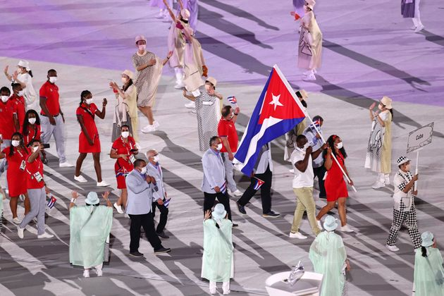 TOKYO, JAPAN - JULY 23: Flag bearers Yaime Perez and Mijain Lopez Nunez of Team Cuba during the Opening...