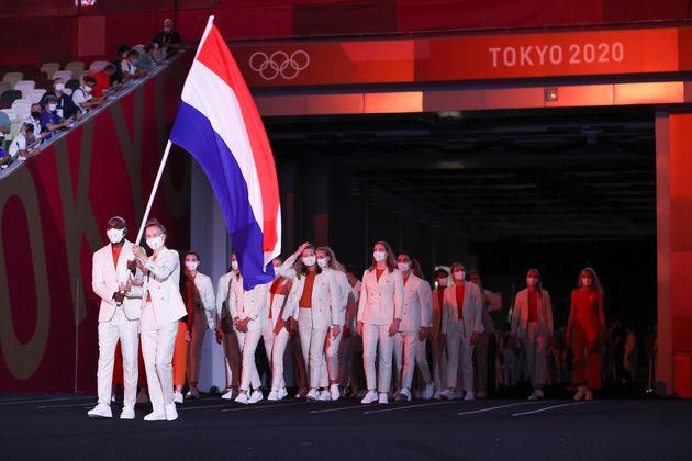TOKYO, JAPAN - JULY 23: Flag bearers Keet Oldenbeuving and Churandy Martina of Team Netherlands lead...