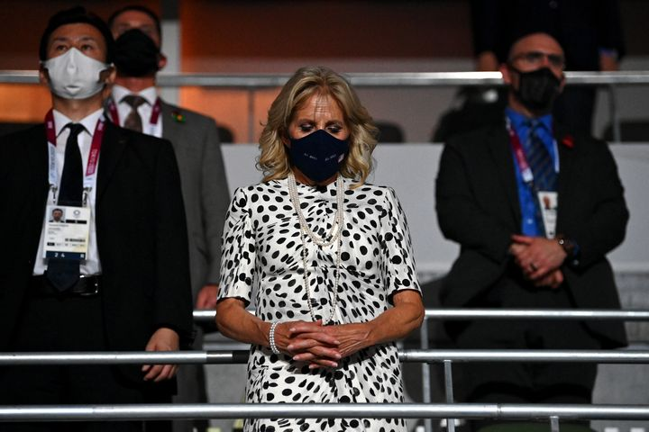Jill Biden takes part in a moment of silence at the opening ceremony.