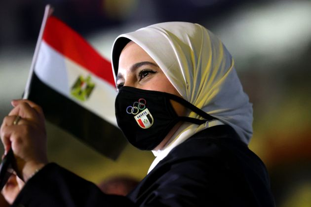 TOKYO, JAPAN - JULY 23: A member of Team Egypt waves a flag during the Opening Ceremony of the Tokyo...