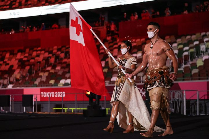 Tonga's flag bearers Malia Paseka (L) and Pita Taufatofua lead the delegation.