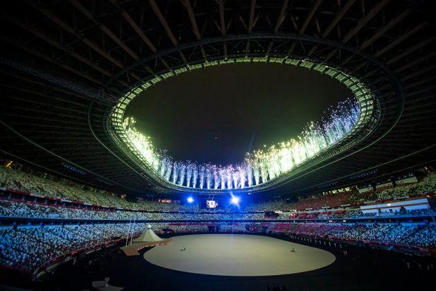 Fireworks flash above the National Stadium.