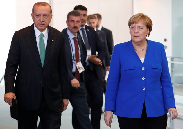 German Chancellor Angela Merkel and Turkish President Tayyip Erdogan arrive for a news conference at...