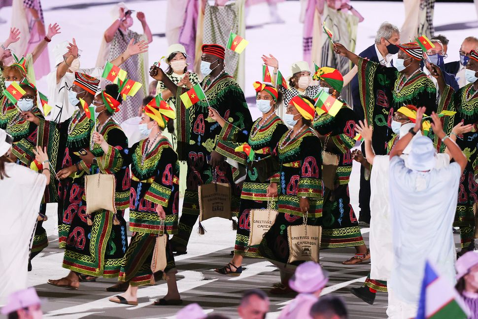 Team Cameroon enters the arena.