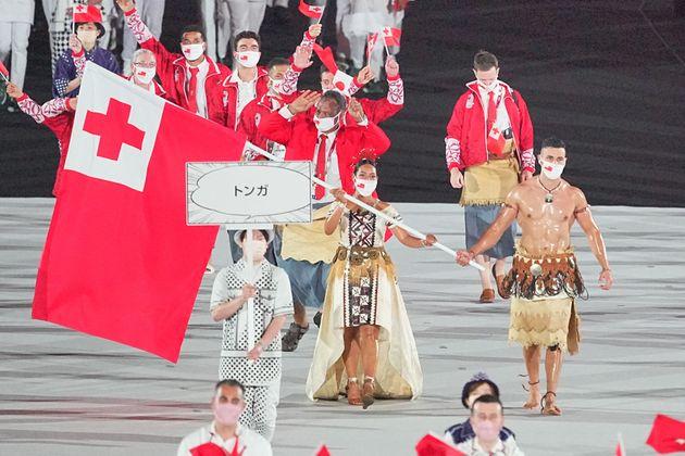 23 July 2021, Japan, Tokio: Olympics: Opening Ceremony at Olympic Stadium. Tonga flag bearers Malia Paseka and taekwondo fighter Pita Taufatofua lead the team into the Olympic Stadium at the opening ceremony of the 2020 Olympics. Photo: Michael Kappeler/dpa (Photo by Michael Kappeler/picture alliance via Getty Images)