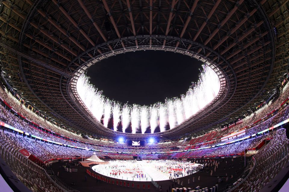 TOKYO, JAPAN - JULY 23: A general view of Fireworks as the athletes watch on during the Opening Ceremony...