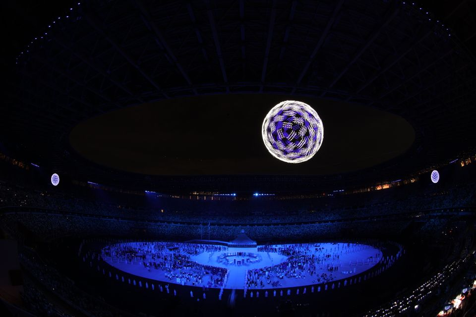 TOKYO, JAPAN - JULY 23: Drones fly over the stadium during the Opening Ceremony of the Tokyo 2020 Olympic...