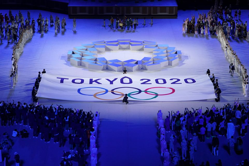 The Olympic teams from every country watch performers on stage during the opening ceremony of the Tokyo...
