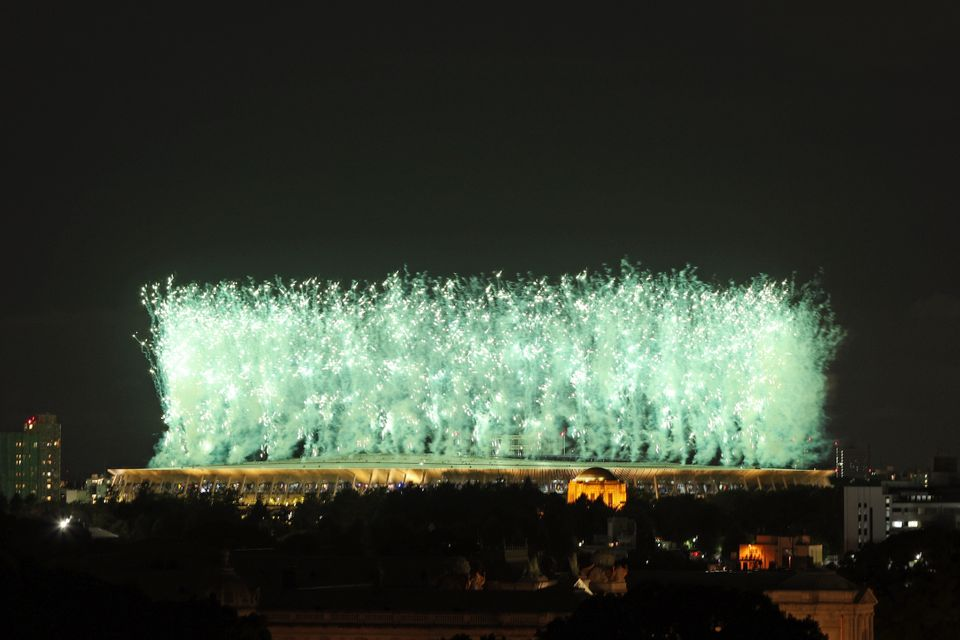 TOKYO, JAPAN - JULY 23: Fireworks are seen from outside the stadium during the Opening Ceremony of the...