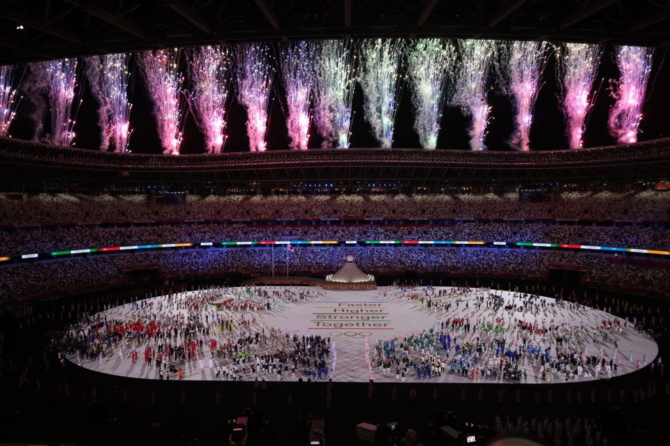 23 July 2021, Japan, Tokio: Olympics: Opening ceremony at the Olympic Stadium. The athletes stand on...