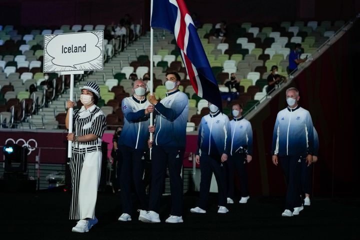 Snaefridur Sol Jorunnardottir and Anton Mckee, of Iceland, carry their country's flag during the opening ceremony.
