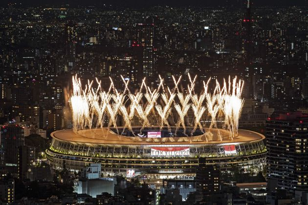 Fireworks light up the sky over the Olympic Stadium during the opening ceremony of the Tokyo 2020 Olympic Games, in Tokyo, on July 23, 2021. (Photo by Charly TRIBALLEAU / AFP) (Photo by CHARLY TRIBALLEAU/AFP via Getty Images)