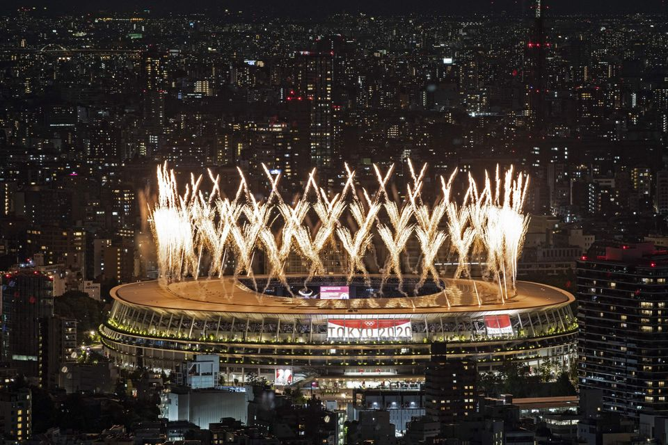 Fireworks light up the sky over the Olympic Stadium during the opening ceremony of the Tokyo 2020 Olympic...
