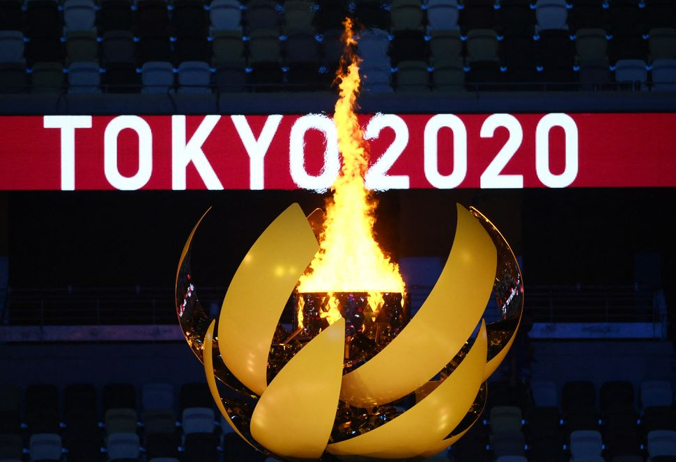 The Olympic Flame burns.