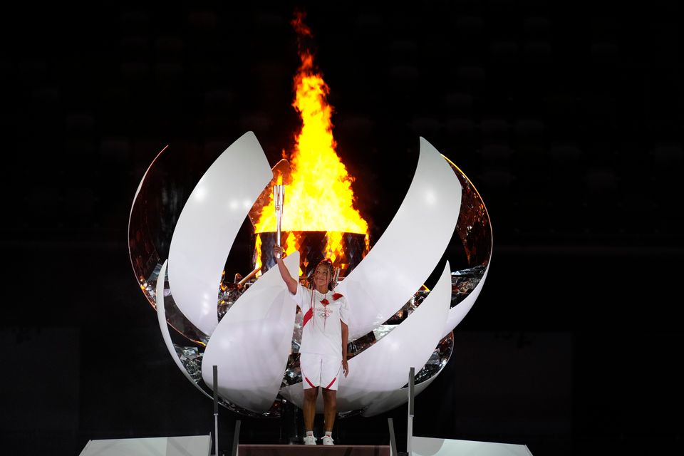 Japan's Naomi Osaka lights the cauldron during the opening ceremony in the Olympic Stadium at the 2020...