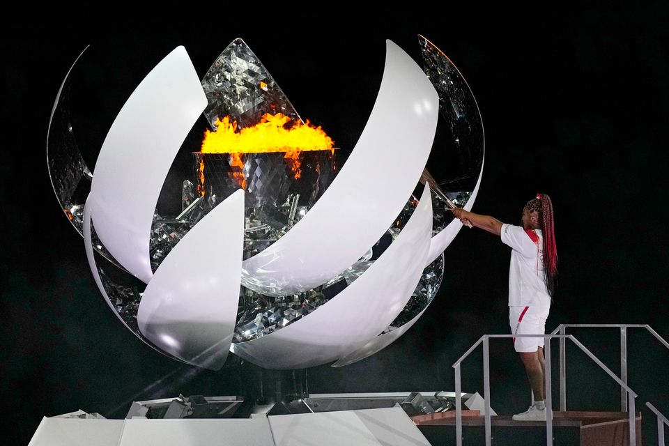 Naomi Osaka lights the Olympic flame during the opening ceremony in the Olympic Stadium at the 2020 Summer...
