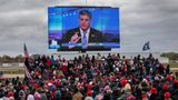 Trump supporters watch Sean Hannity speak ahead of Trump's arrival at a campaign rally in Waterford, Michigan, last year.