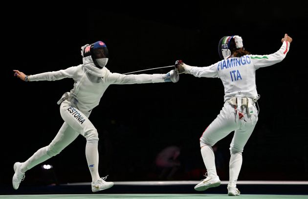 Italy's Rossella Fiamingo (R) compete against Estonia's Katrina Lehis in the women's epee individual...