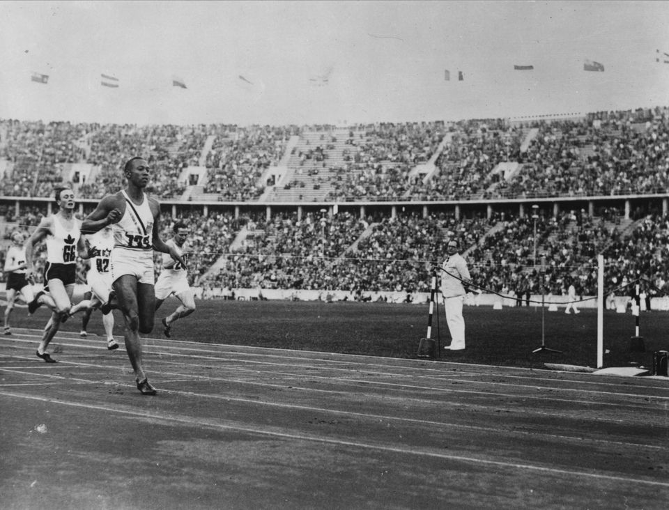 August 1936: US athlete Jesse Owens (1913 - 1980) competing in a race during the Olympic Games at Berlin....