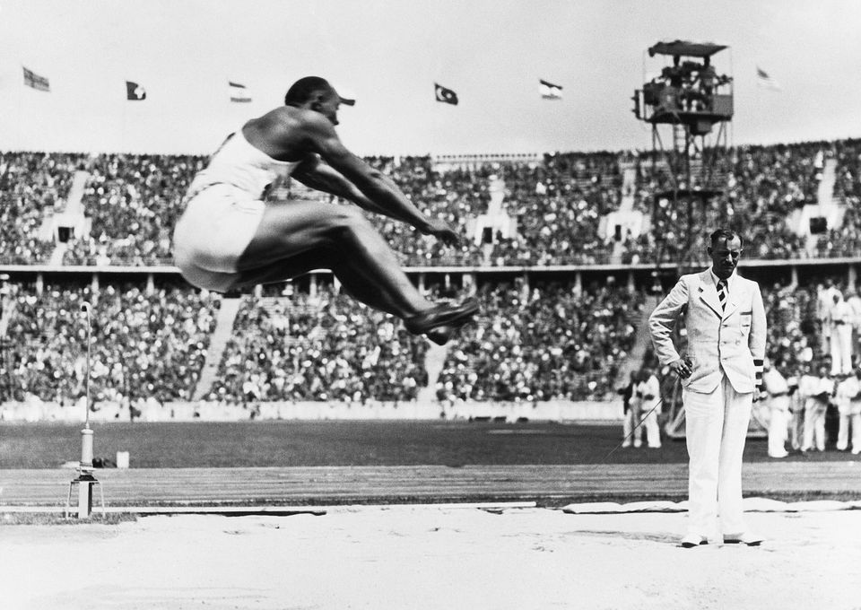 (Original Caption) 8/8/1936-Berlin, Germany- Jesse Owens soars through the air with the greatest of ease...