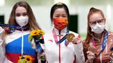 ASAKA, JAPAN - JULY 24: (L - R) Silver medalist Anastasiia Galashina of Russia, gold medalist Yang Qian of China and bronze medalist Nina Christen of Switzerland celebrate on the podium after the 10m Air Rifle Women's Final on the first day of the Tokyo 2020 Olympic Games at the Asaka Shooting Range on July 24, 2021 in Asaka, Saitama, Japan. (Photo by Du Yang/China News Service via Getty Images)