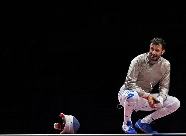 Italy's Luigi Samele celebrates after winning against South Korea's Kim Junghwan in the men's sabre individual...
