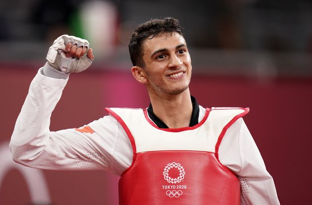 Italy's Vito Dell'Aquila celebrates victory against Tunisia's Mohamed Khalil Jendoubi to win the gold...