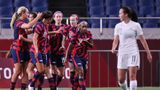 USA's players celebrate their opening goal during the Tokyo 2020 Olympic Games women's group G first round football match between New Zealand and USA at the Saitama Stadium in Saitama on July 24, 2021. (Photo by Ayaka Naito / AFP) (Photo by AYAKA NAITO/AFP via Getty Images)
