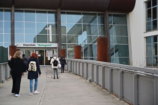 A picture show people arriving at the Bolognini hospital in Seriate, near Bergamo, on March 12, 2021....