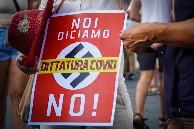 Demonstration against Green Pass in Dante square, Naples, Italy, 24 july 2021. ANSA/CESARE ABBATE