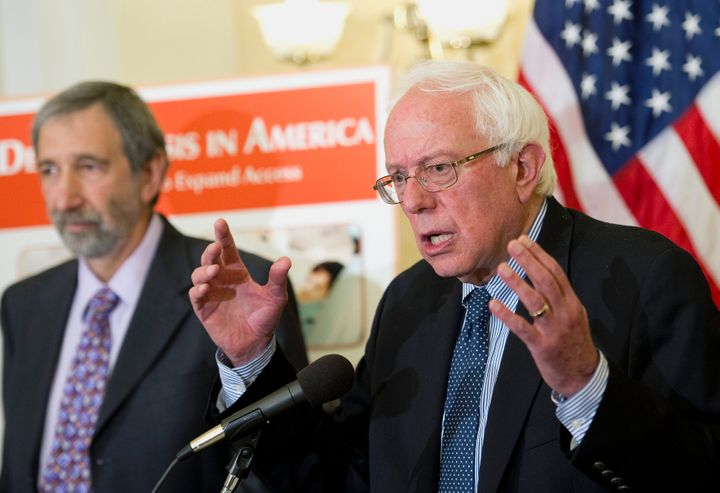 Paul Glassman, the director for the Pacific Center for Special Care, and Sen. Bernie Sanders (I-Vt.) speak at a news conferen