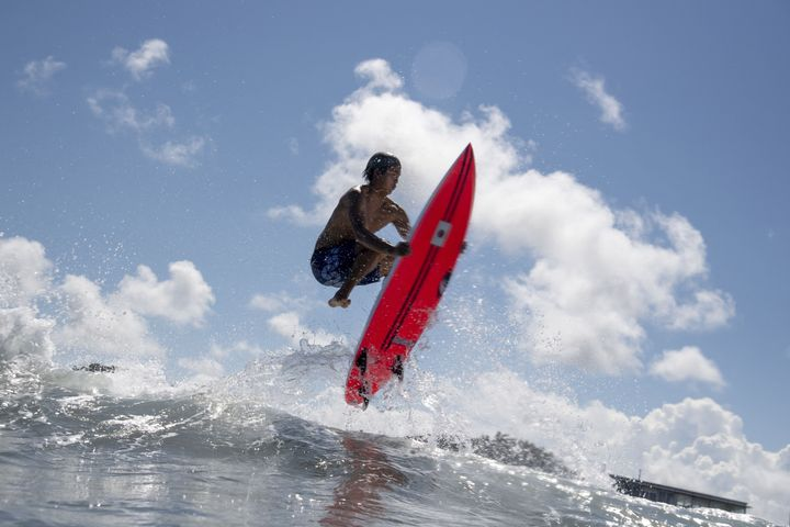 Japan's Kanoa Igarashi rides a wave during a free training session at the Tsurigasaki Surfing Beach.
