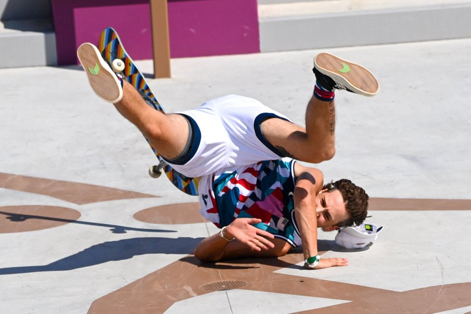 Jagger Eaton of the US takes a fall as he competes in the men's street prelims heat