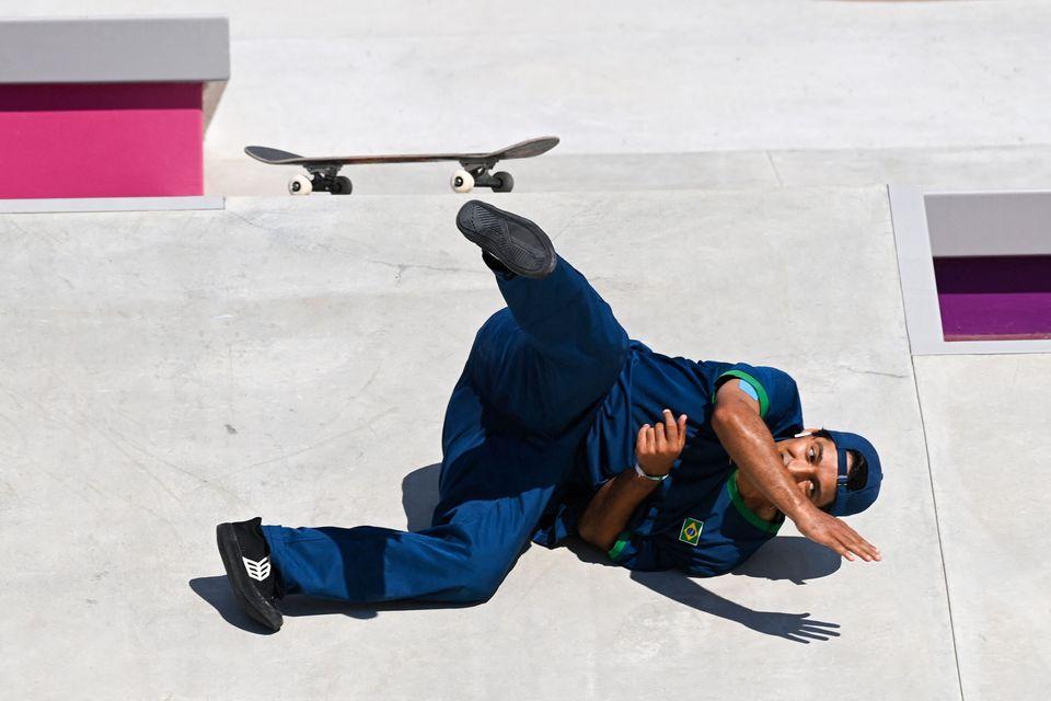 Brazil's Kelvin Hoefler takes a fall as he competes in the men's street prelims heat