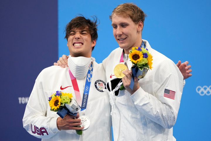 Gold medalist Chase Kalisz, (right) celebrates on the podium with silver medalist and teammate Jay Litherland after winning t