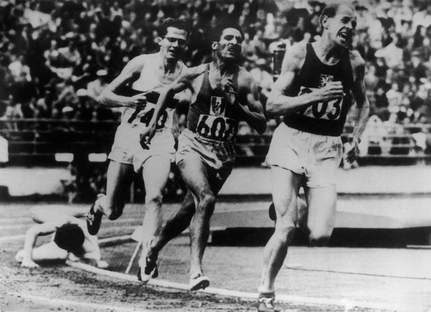 FINLAND - JULY 29: In the dramatic finish to the 5000 metres in the '52 Olympics, Britain's Chris Chataway falls on the final bend as Emil Zatopek of Czechoslovakia sprints away to win the gold medal. France's Alain Mimoun, number 607, will take the silver ahead of Germany's Herbert Schade. (Photo by Keystone-France/Gamma-Keystone via Getty Images)