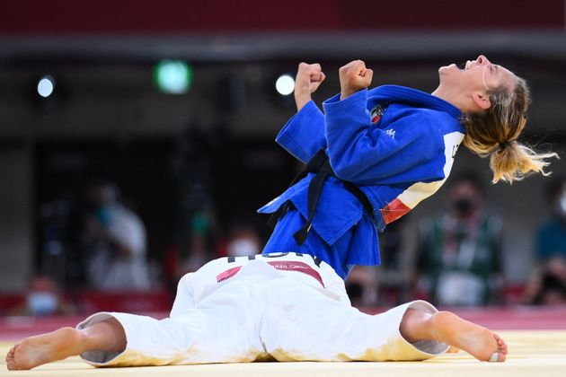 Italy's Odette Giuffrida reacts after defeating Hungary's Reka Pupp during their judo women's -52kg bronze...