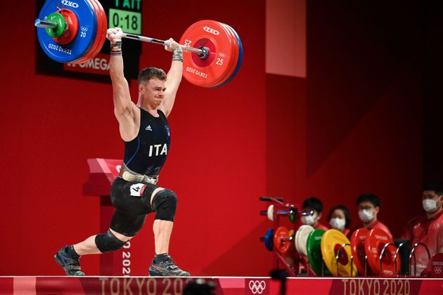 Italy's Mirko Zanni competes in the men's 67kg weightlifting competition during the Tokyo 2020 Olympic...