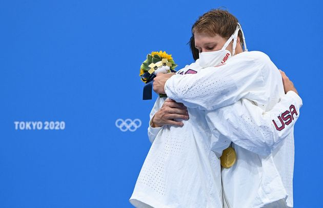 Silver medallist USA's Jay Litherland (L) and gold medallist USA's Chase Kalisz hug each other on the...