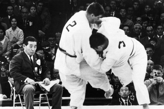 Picture taken on October 23, 1964 at Tokyo showing Netherlands' judoka Anton Geesink (L) during the fight against Japanese Akio Kaminaga. Geesink wins the combat and become Olympic champion. (Photo by - / AFP) (Photo by -/AFP via Getty Images)