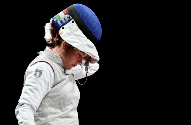 Italy's Alice Volpi reacts after loosing against Russia's Inna Deriglazova in the women's foil individual semi-final bout during the Tokyo 2020 Olympic Games at the Makuhari Messe Hall in Chiba City, Chiba Prefecture, Japan, on July 25, 2021. (Photo by Fabrice COFFRINI / AFP) (Photo by FABRICE COFFRINI/AFP via Getty Images)
