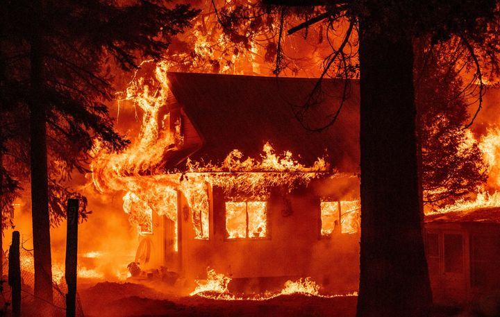 A home burns as the Dixie fire rips through the Indian Falls neighborhood of unincorporated Plumas County, California, on Jul