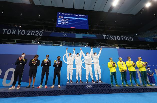 TOKYO, JAPAN - JULY 26: Silver medalists Alessandro Miressi, Thomas Ceccon, Lorenzo Zazzeri and Manuel Frigo of Team Italy, gold medalists Caeleb Dressel, Blake Pieroni, Bowen Becker and Zach Apple of Team United States and bronze medalists Matthew Temple, Zac Incerti, Alexander Graham and Kyle Chalmers of Team Australia pose during the medal ceremony for the Men's 4 x 100m Freestyle Relay Final on day three of the Tokyo 2020 Olympic Games at Tokyo Aquatics Centre on July 26, 2021 in Tokyo, Japan. (Photo by Clive Rose/Getty Images)