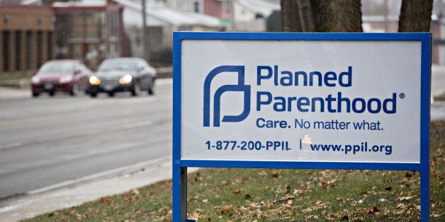 Signage is displayed outside a Planned Parenthood office in Peoria, Illinois, U.S., on Friday, Dec. 16, 2016. Republicans are