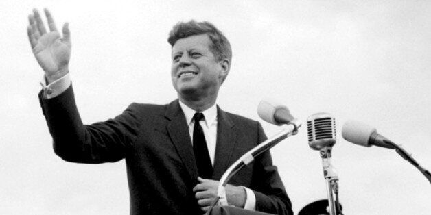 File photo dated 27/06/1963 of US President John F. Kennedy acknowledging the cheers of the crowd when he visits New Ross, Co
