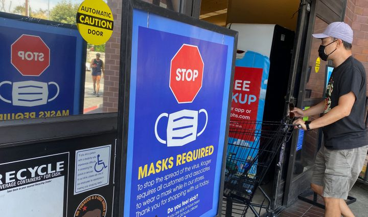 People shop at a grocery store enforcing the wearing of masks in Los Angeles on July 23.