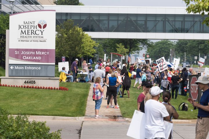Health care workers and others gathered at several hospitals throughout Michigan on Saturday to protest the recent announceme