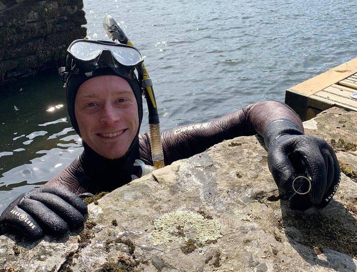 Lake District Divers volunteer Angus Hosking with Mick Balchin's wedding ring