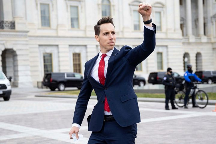 Sen. Josh Hawley (R-Mo.) gesturing toward a crowd of supporters of then-President Donald Trump who had gathered outside the U