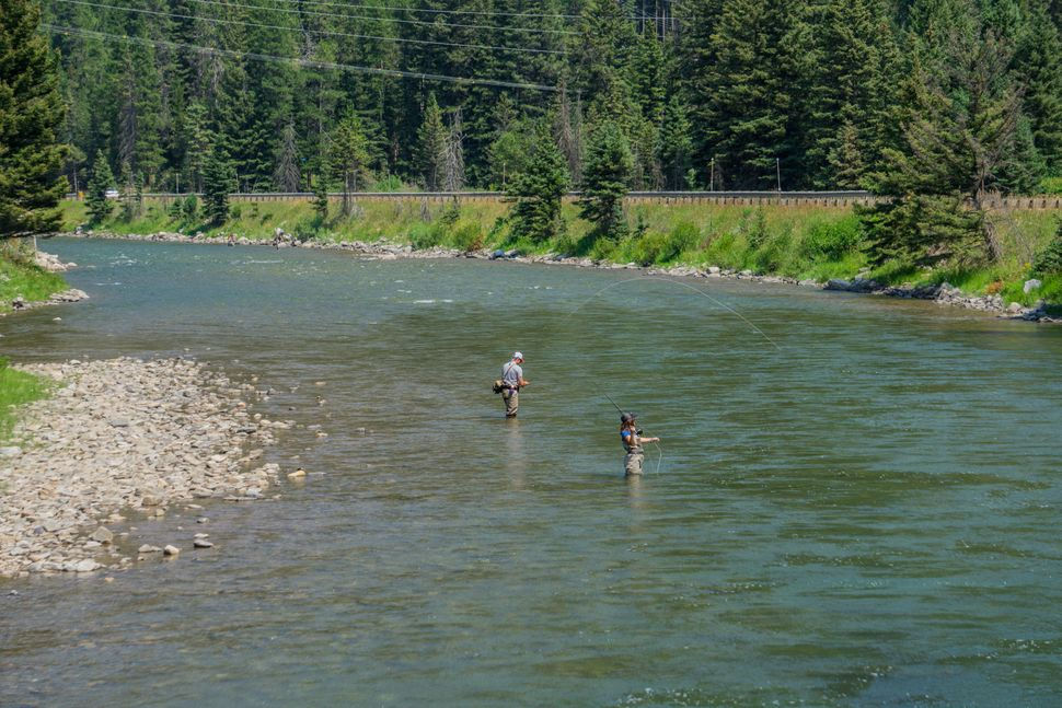 Two anglers cast their lines on the Gallatin River south of Bozeman, Montana.